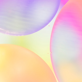 Gradient abstract bubbles on colorful vivid blurred background