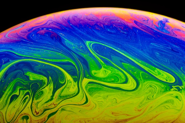 Gradient abstract psychedelic soap bubble on black background