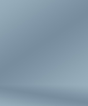 グラデーションブルーの抽象的な背景。ブラックビネットスタジオで滑らかなダークブルー