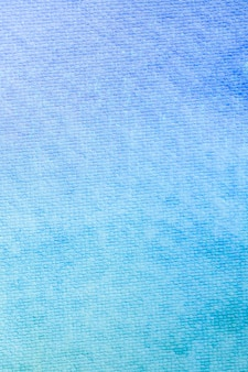 Gradient blue watercolor background.