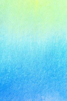 グラデーションブルーイエローとグリーンの水彩画の背景。