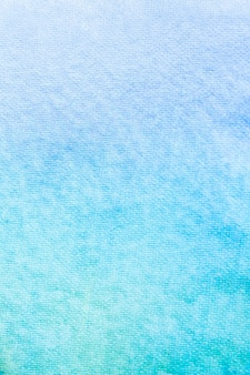 Gradient blue yellow and green watercolor background.