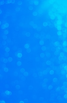 Gradient ultramarine blue illuminated bokeh for abstract background