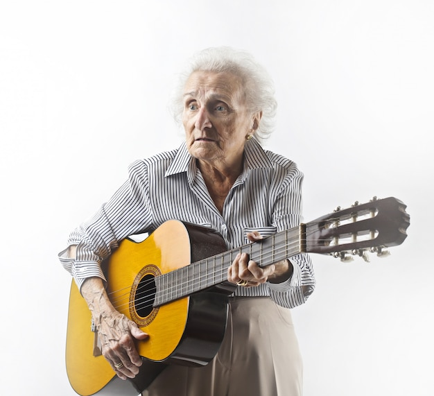 Gradma playing on a guitar