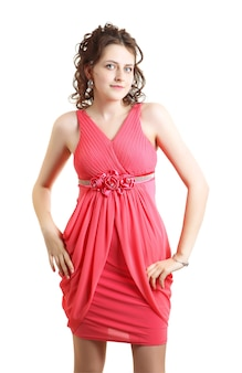 Graduate of school wore evening dress coral color for school prom.