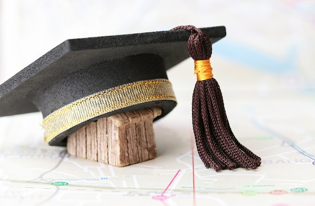 Graduate study abroad inter school concept : graduation cap on on  bangkok city