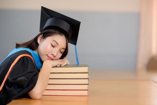 Graduates read books in university libraries.