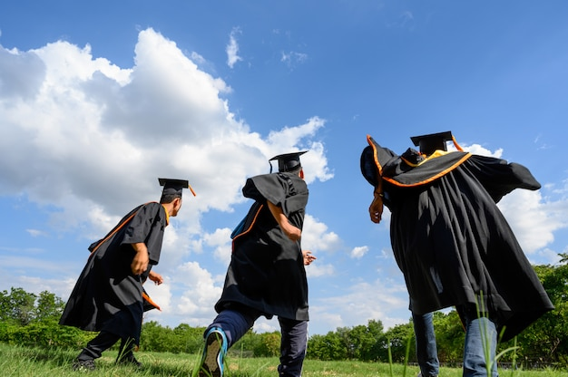 Graduates throw hats on graduation day at the university.