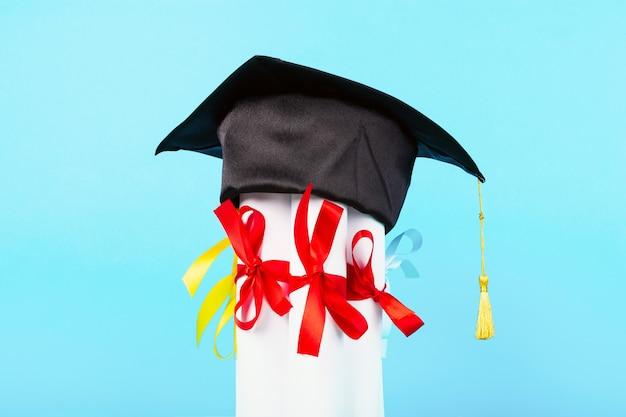 Graduation cap on diplomas