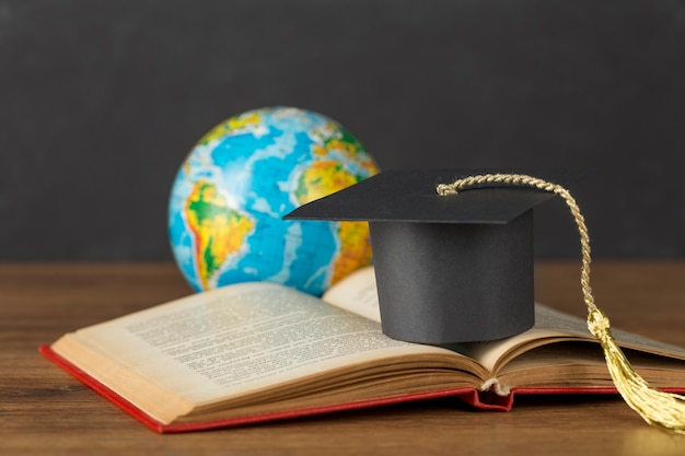 Graduation cap and earth globe arrangement