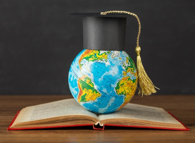 Graduation cap on earth globe