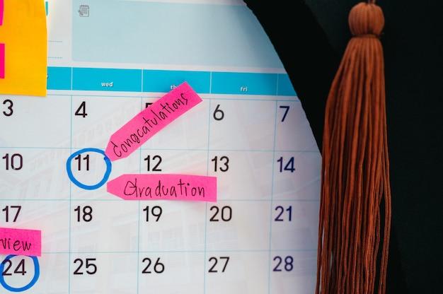 Graduation ceremony graduation cap on white clean calendar