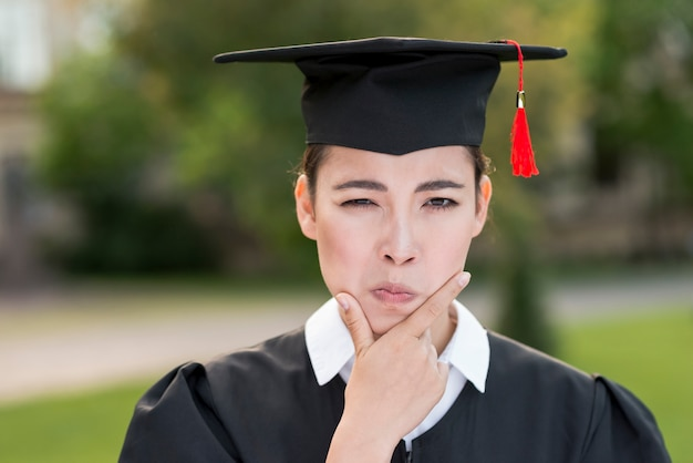 Graduation concept with portrait of happy girl