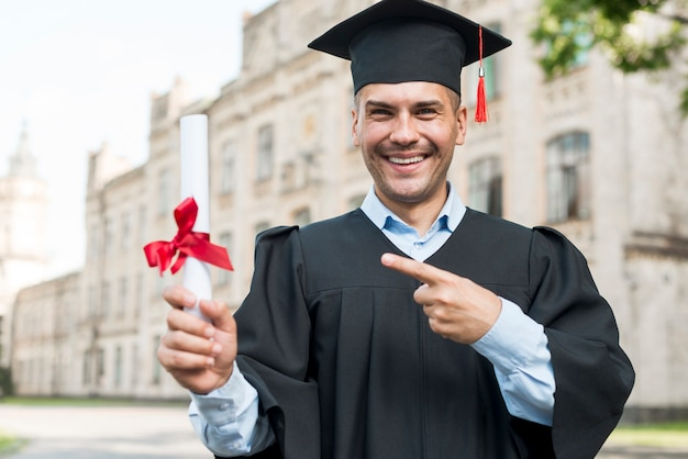 Graduation concept with portrait of happy man