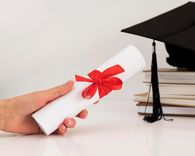 Graduation diploma certificate with ribbon and bow
