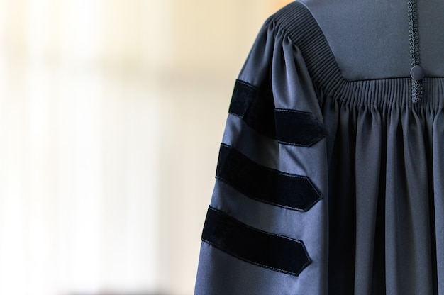 Graduation gown hanging in the cupboard