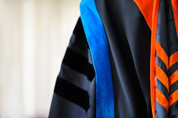 Graduation gowns hanging in the cupboard