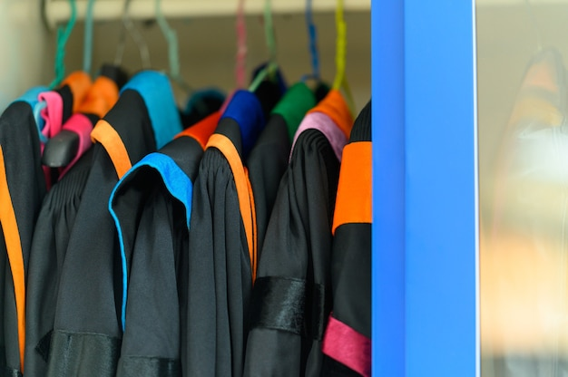 Graduation gowns hanging in the cupboards