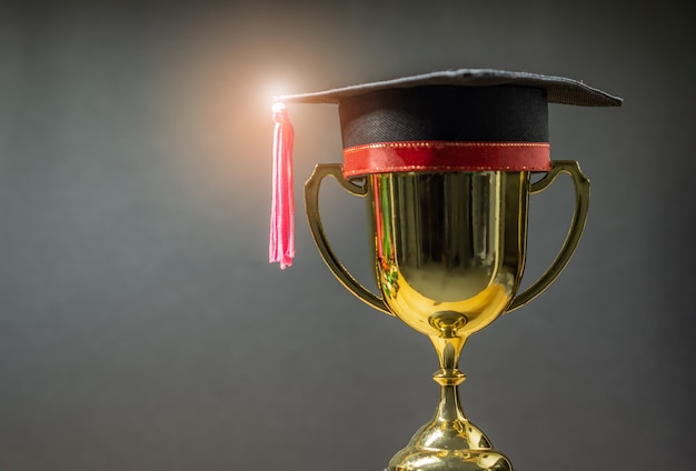 Graduation hat with golden trophy