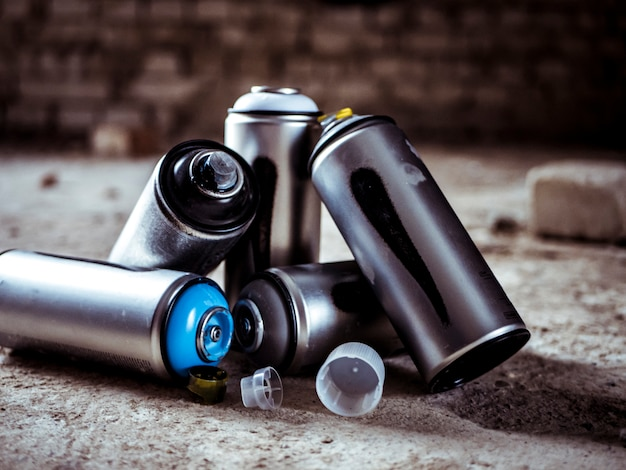 Graffiti spray paint aerosol cans close up shot