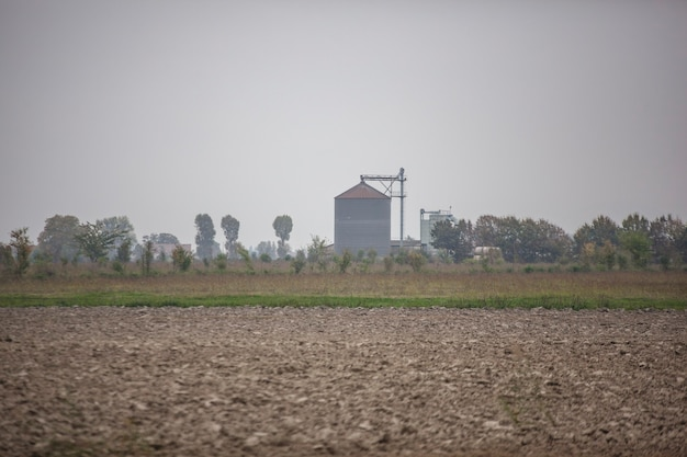 Grain dryer in the countryside during the autumn