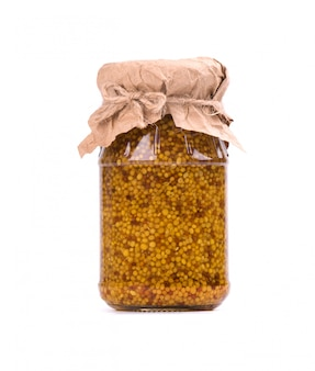 Grain mustard sauce isolated . mustard beans in a jar isolated . closeup