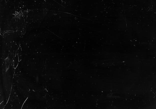 그레인 노이즈 텍스처. 검은 그런지 사진 편집기에 얼룩이 묻은 얼룩 효과가있는 더러운 표면을 풍화.