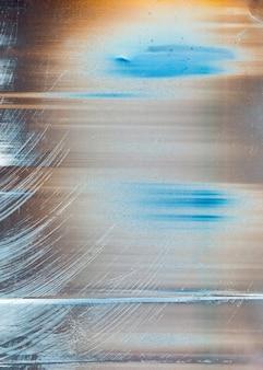 그레인 노이즈 텍스처. 먼지 스크래치 아트 벽지와 그런 지 표면에 오렌지 블루 베이지 얼룩진 잉크 홍당무 스트로크.