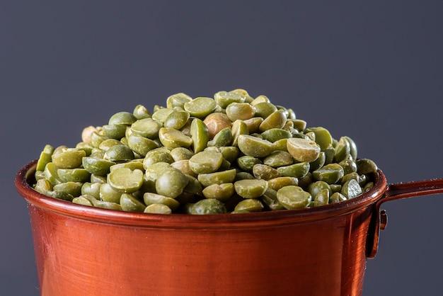 Grains of dried pea in a mug.