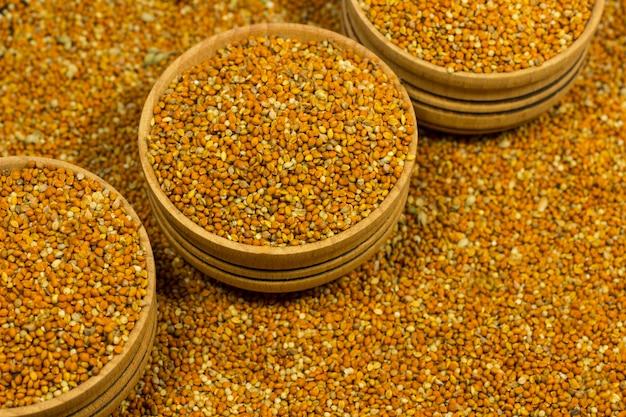 Grains of millet in wooden bowls
