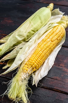 Grains of ripe corn on wooden table. wooden background. top view.