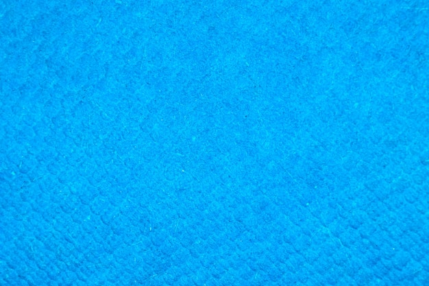 Grainy detailed blue paper texture and grunge surface background close-up photo