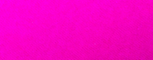 Grainy detailed pink paper texture and grunge surface background close-up photo