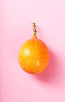 Granadilla on pink surface