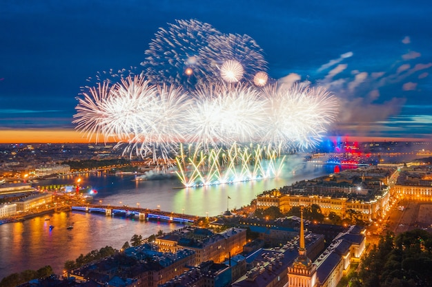 Grand fireworks over the waters of the neva river in st. petersburg, visible palace bridge, peter and paul fortress.