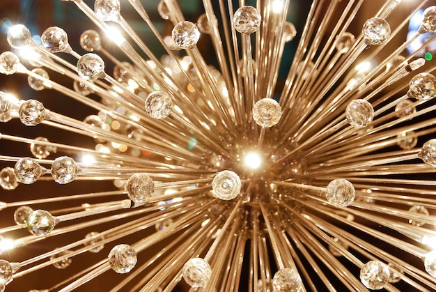 A grand glass shiny ceiling chandelier in the shape of dandelion