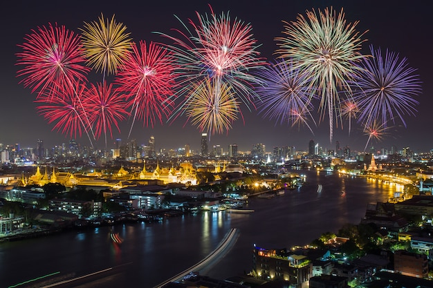 Grand palace and bangkok city with colorful fireworks, thailand