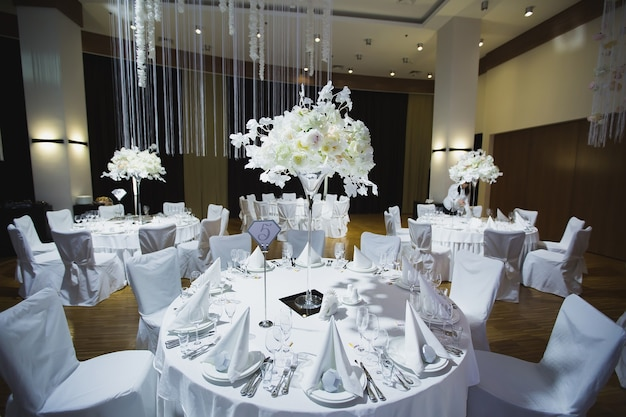 A grand restaurant and a ballroom in a luxury hotel. the interior design is executed in classical style.