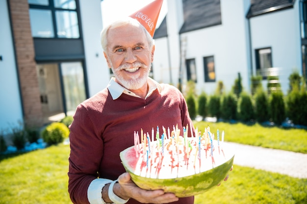 For grandchild. pleased retirement keeping smile on his face while having birthday