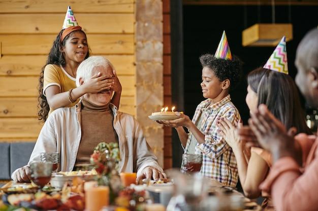 Grandchildren congratulating grandfather with birthday