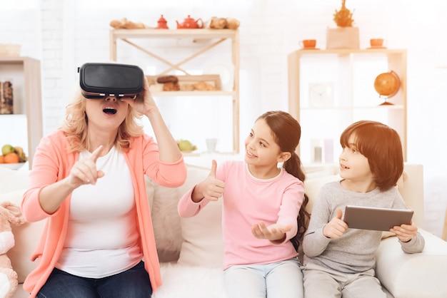 Grandchildren and grandma have fun with vr glasses