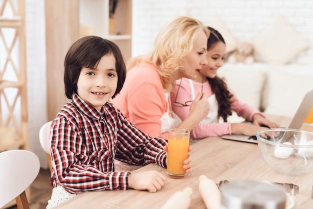Grandchildren with grandmother in kitchen