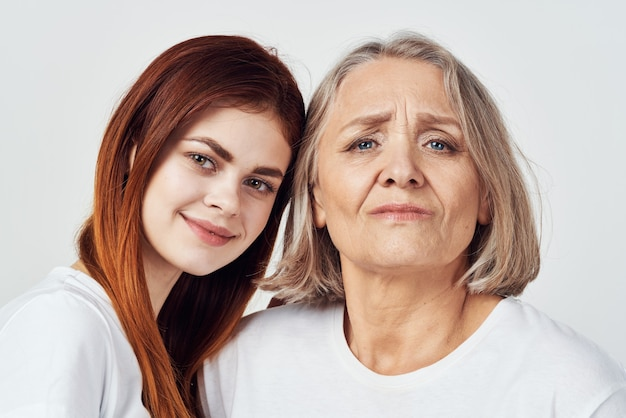 Granddaughter and grandmother are standing next to family love studio