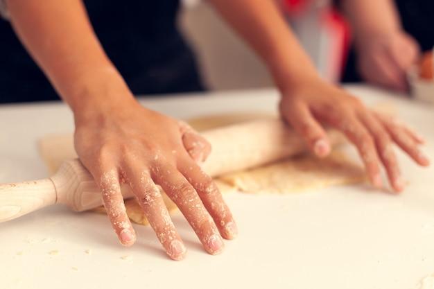 Granddaughter knead dough on christmas day