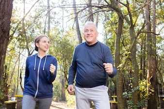 Grandfather and granddaughter exercising