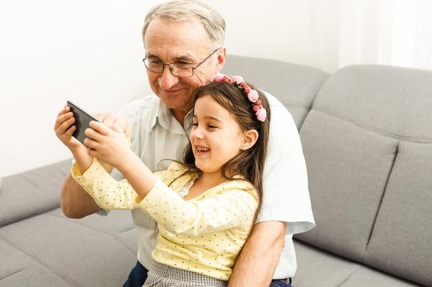 Grandfather and granddaughter make selfie