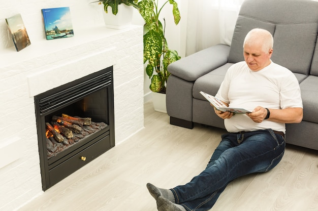 Grandfather reading story book at home