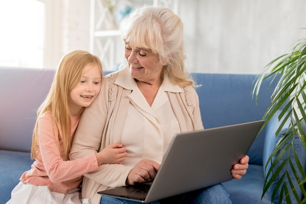 Grandma and girl looking at laptop