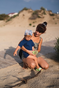 Grandma and grandson at beach playing