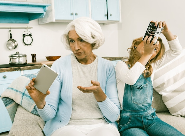 Grandma and her grandchild cannot understand each other's gadgets